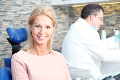 smiling woman sitting in dentist chair
