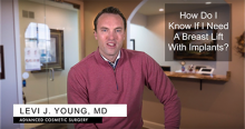 Kansas City plastic surgeon discusses breast lifts with breast implants to patients