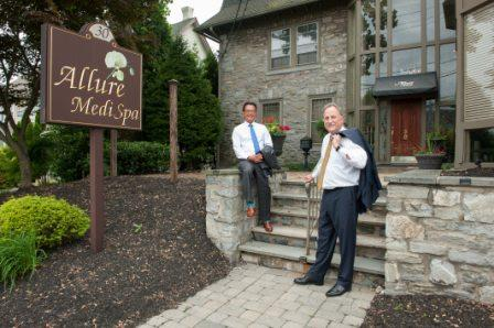 board-certified plastic surgeons Dr. Paul Kim and Dr. Gary Wingate on the steps outside of Allure Medi-Spa