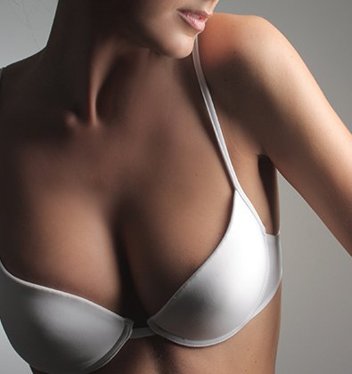 Woman's Chest with Natural-Looking Enhanced Breasts - Breast Surgery