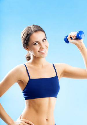 Woman Lifting Light Weights to Meet CDC Exercise Recommendations