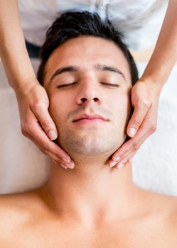 man getting head and neck massage