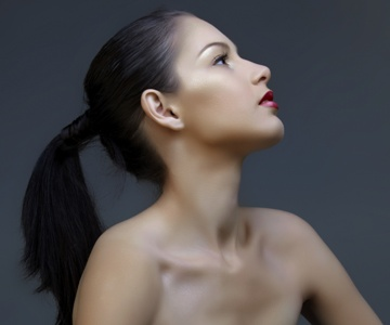 woman stretching her neck to look up