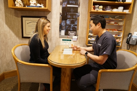 patient meeting with Dr. Aaron Sun about full dentures | Aurora, Colorado
