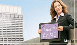 woman holding sign saying 'I Did It for Me'