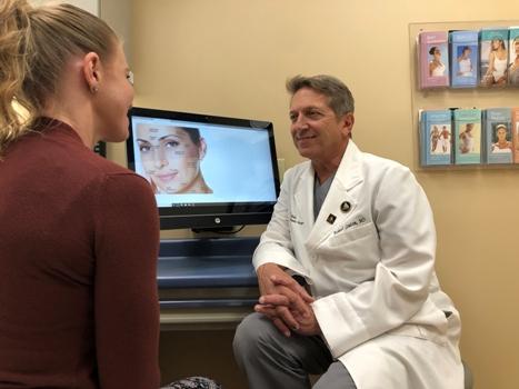 Dr. Robert Louton with facial plastic surgery patient at Blair Plastic Surgery