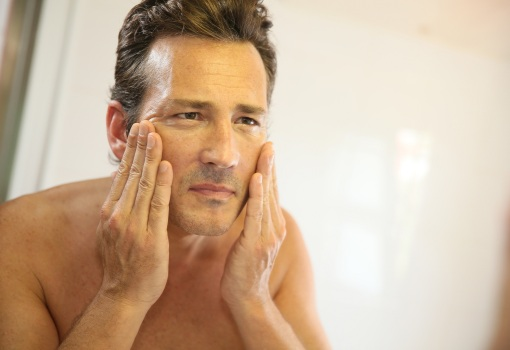 man unhappy with facial wrinkles considering rejuvenation treatment