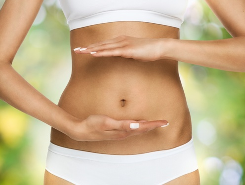 woman focusing on belly fat for body contouring goals