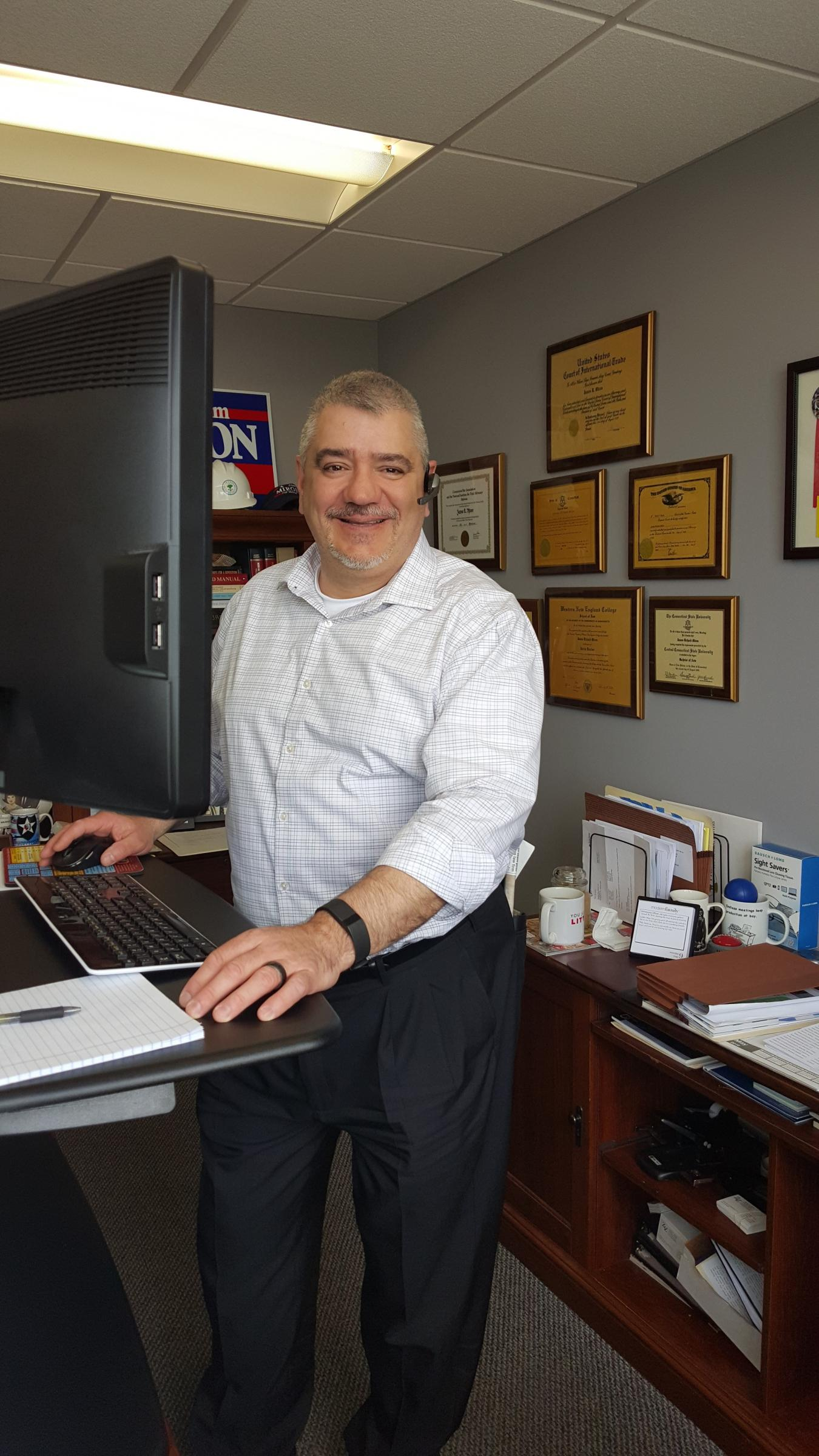 attorney Jim Miron at standing desk in his office