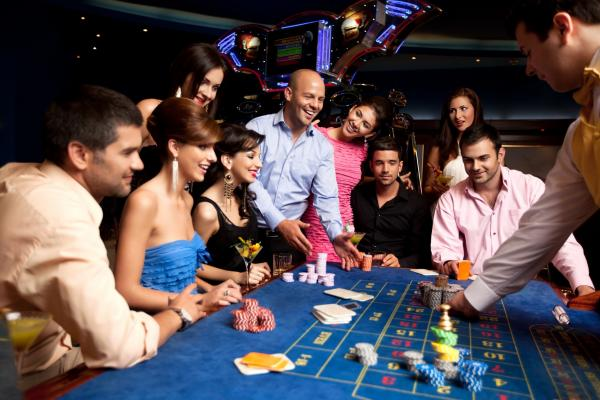 people playing roulette at a casino