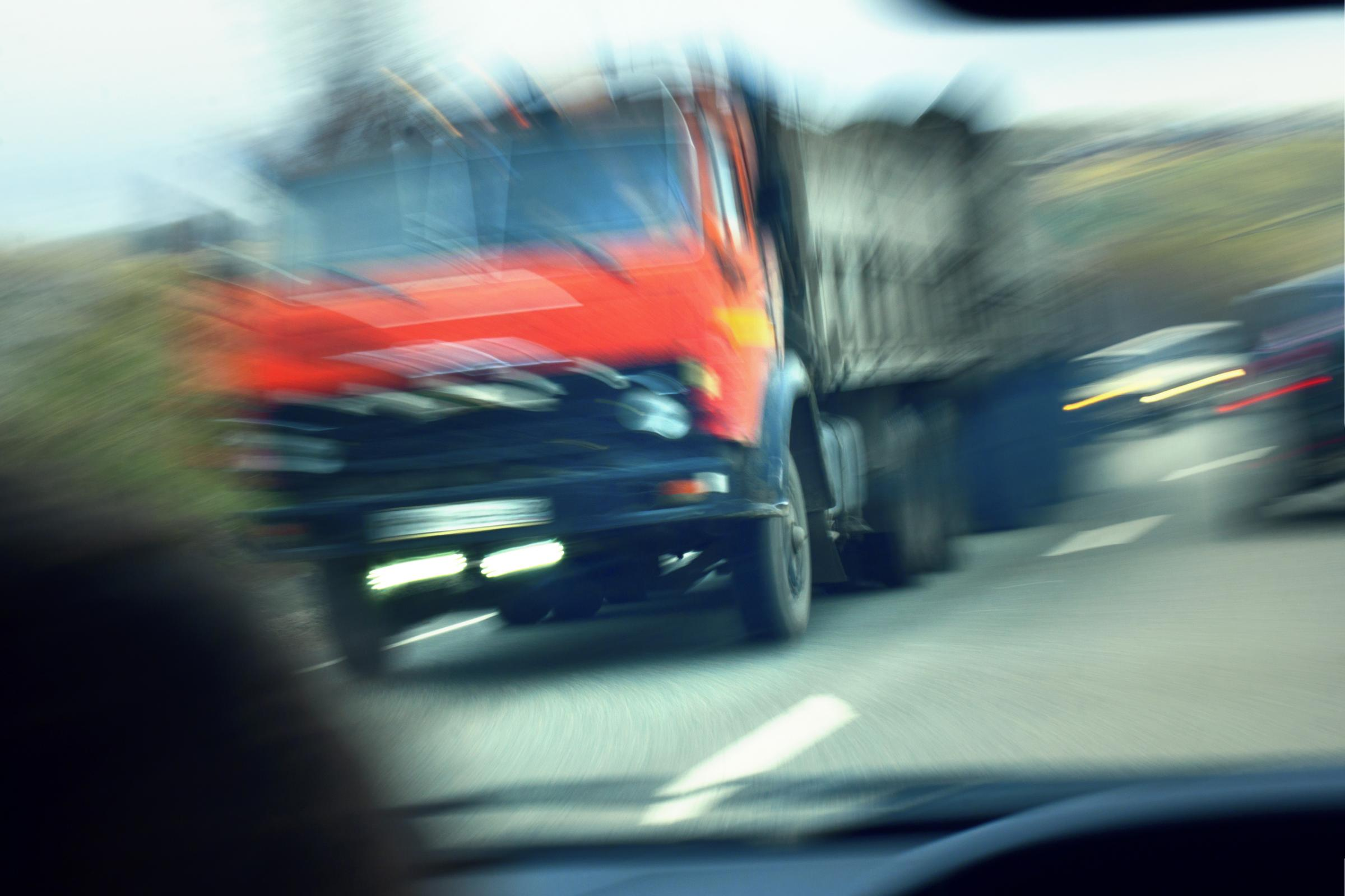 truck about to crash head-on with another car