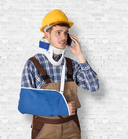 worker with arm and neck injury on the phone with insurance company