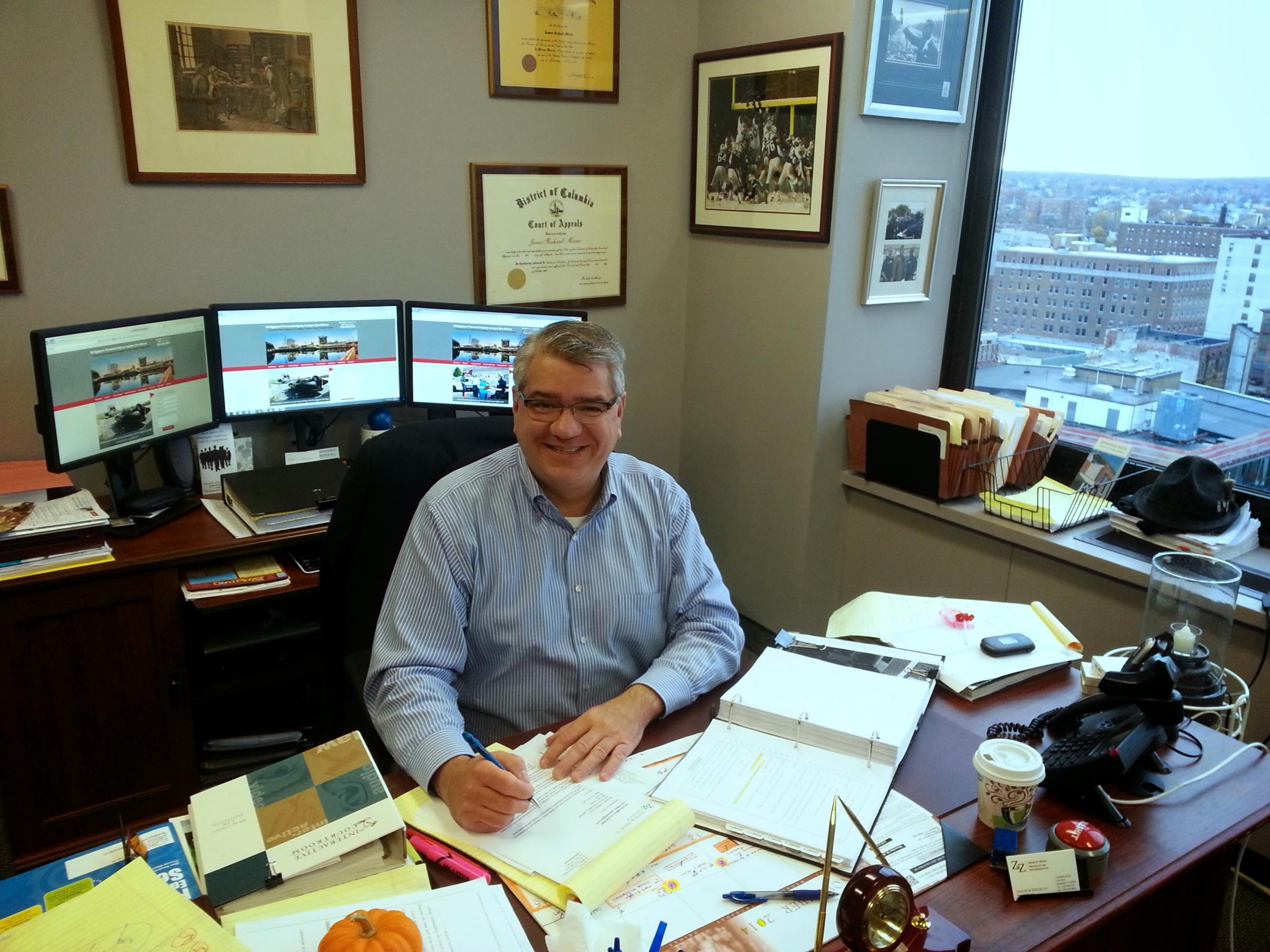 attorney Jim Miron at his desk in his Bridgeport law office