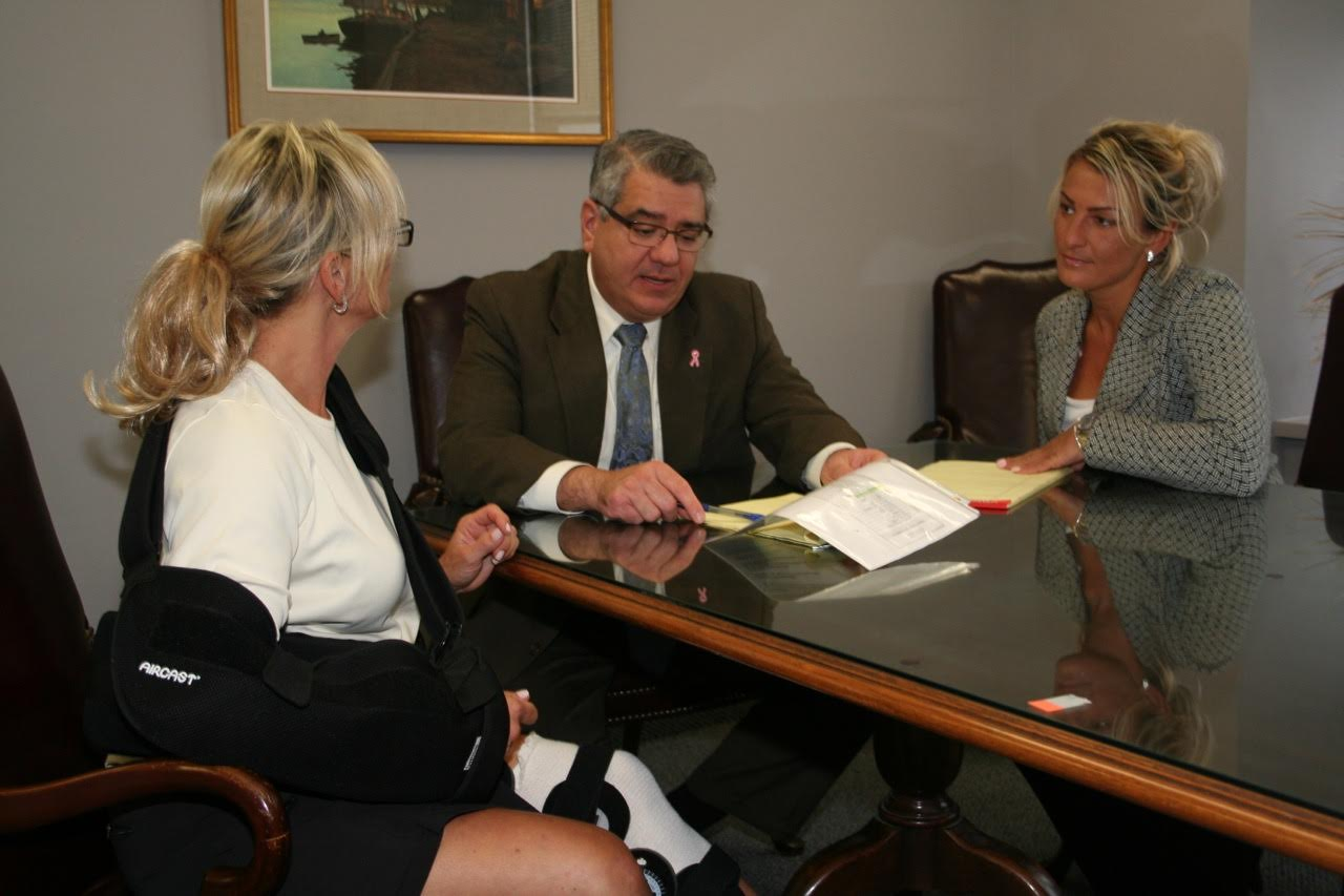 attorney Jim Miron in consultation with personal injury client