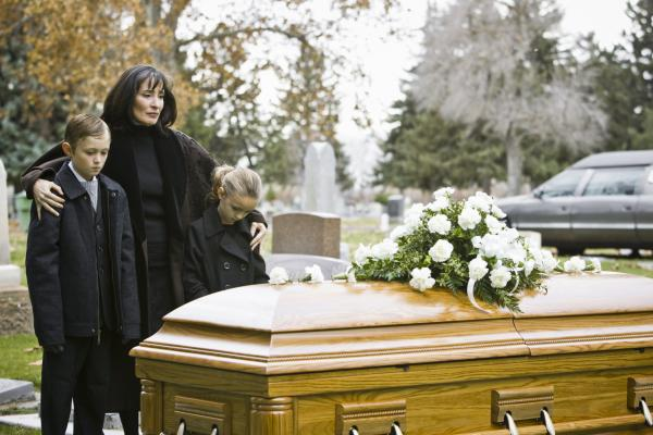 family burying a loved one after a wrongful death