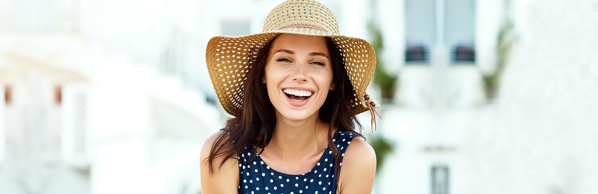 Smiling woman in a sunhat