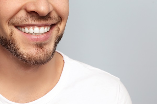 Close-up of a man's smile after dental crown treatment