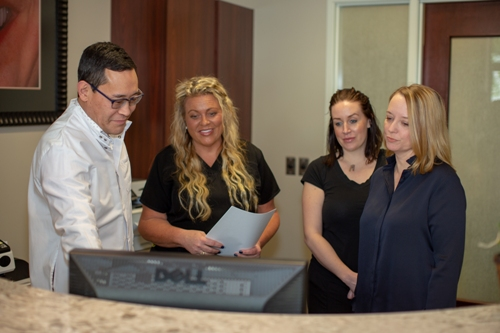 Dr Keith Ogawa and his team at the front desk of Contemporary Dental Health