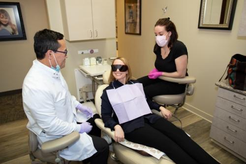 teeth whitening session with Dr. Ogawa and dental assistant