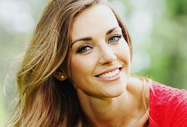 Woman in Nature with a Healthy Smile - TMJ Treatment from Dr. Ryan Clancy