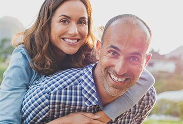 Happy Couple with Big Smiles - Smile Makeover Treatment from Dr. Clancy