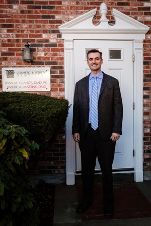 Dr. Ryan Clancy at the front entrance to Cosmetic & Esthetic Dentistry
