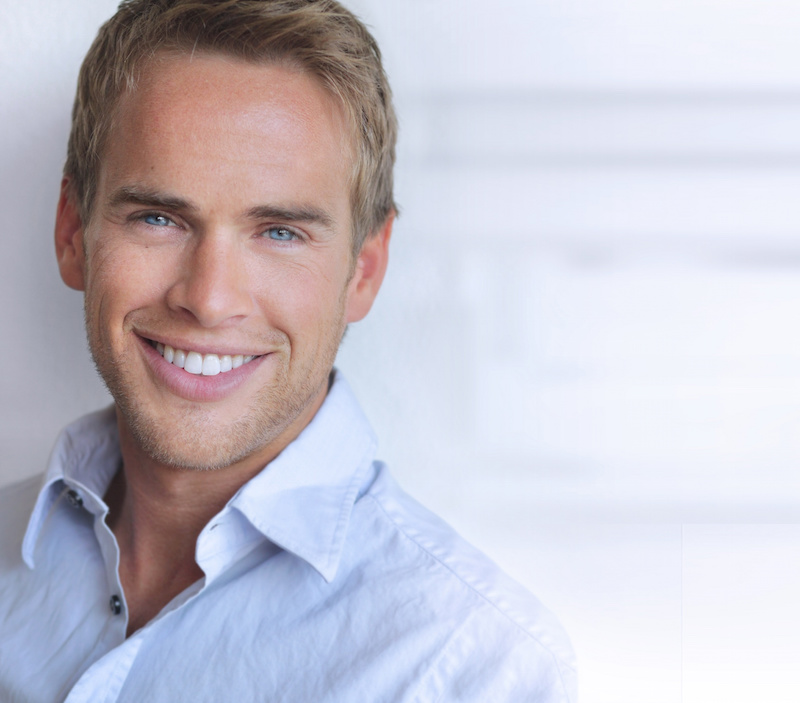 Smiling man with perfect white teeth after porcelain veneers