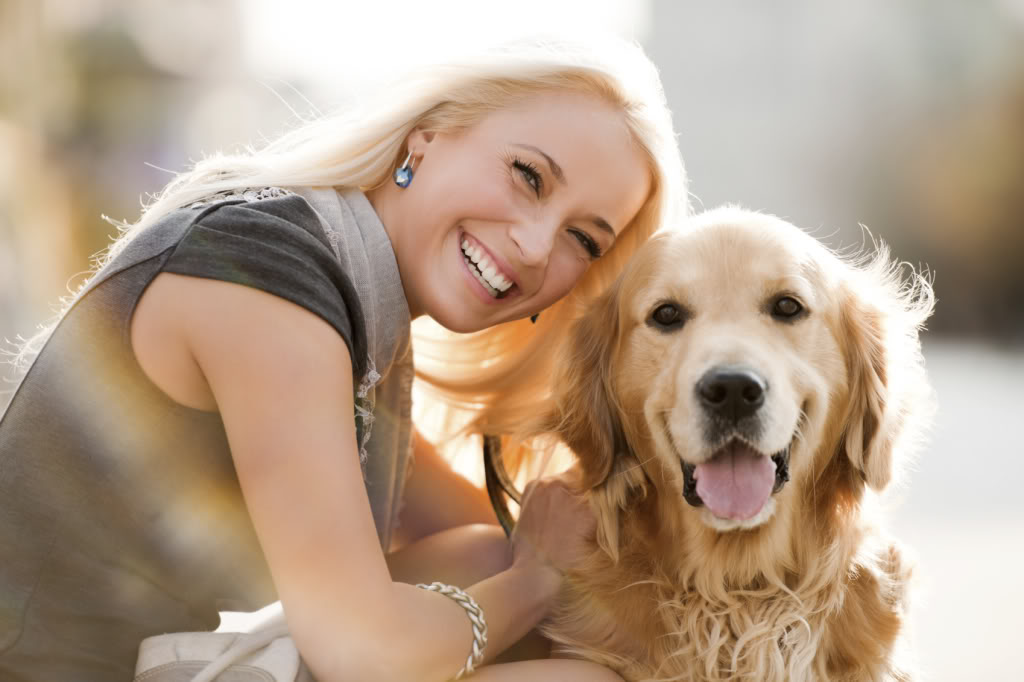 Smiling older woman with nice teeth, beautiful smile, and dog | Dr. Ryan Clancy