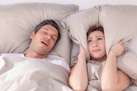 woman distressed by man snoring