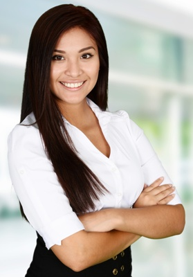 young professional woman with her arms folded