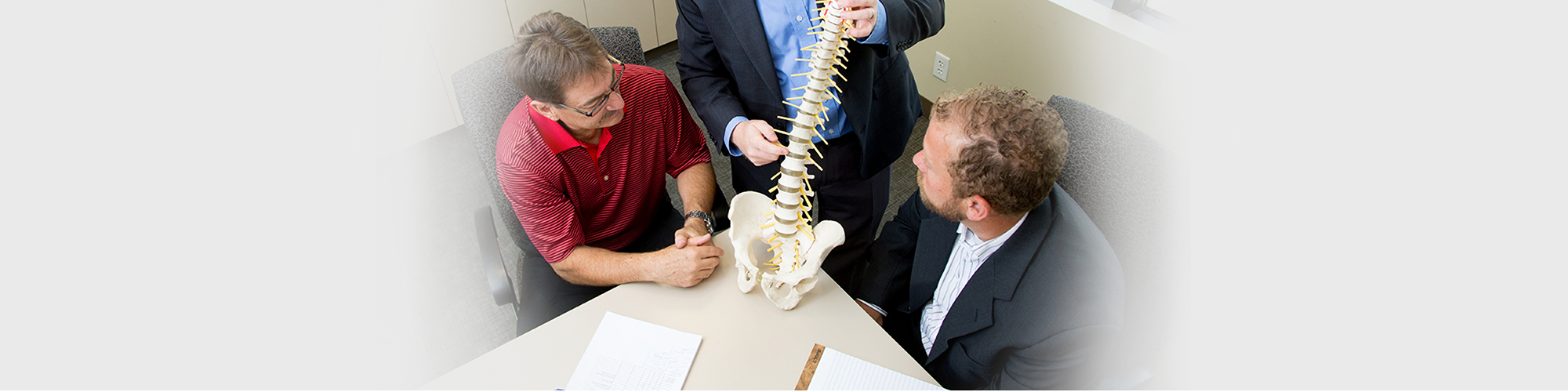 Lawyers showing examples of spinal injuries that can occur while on the job