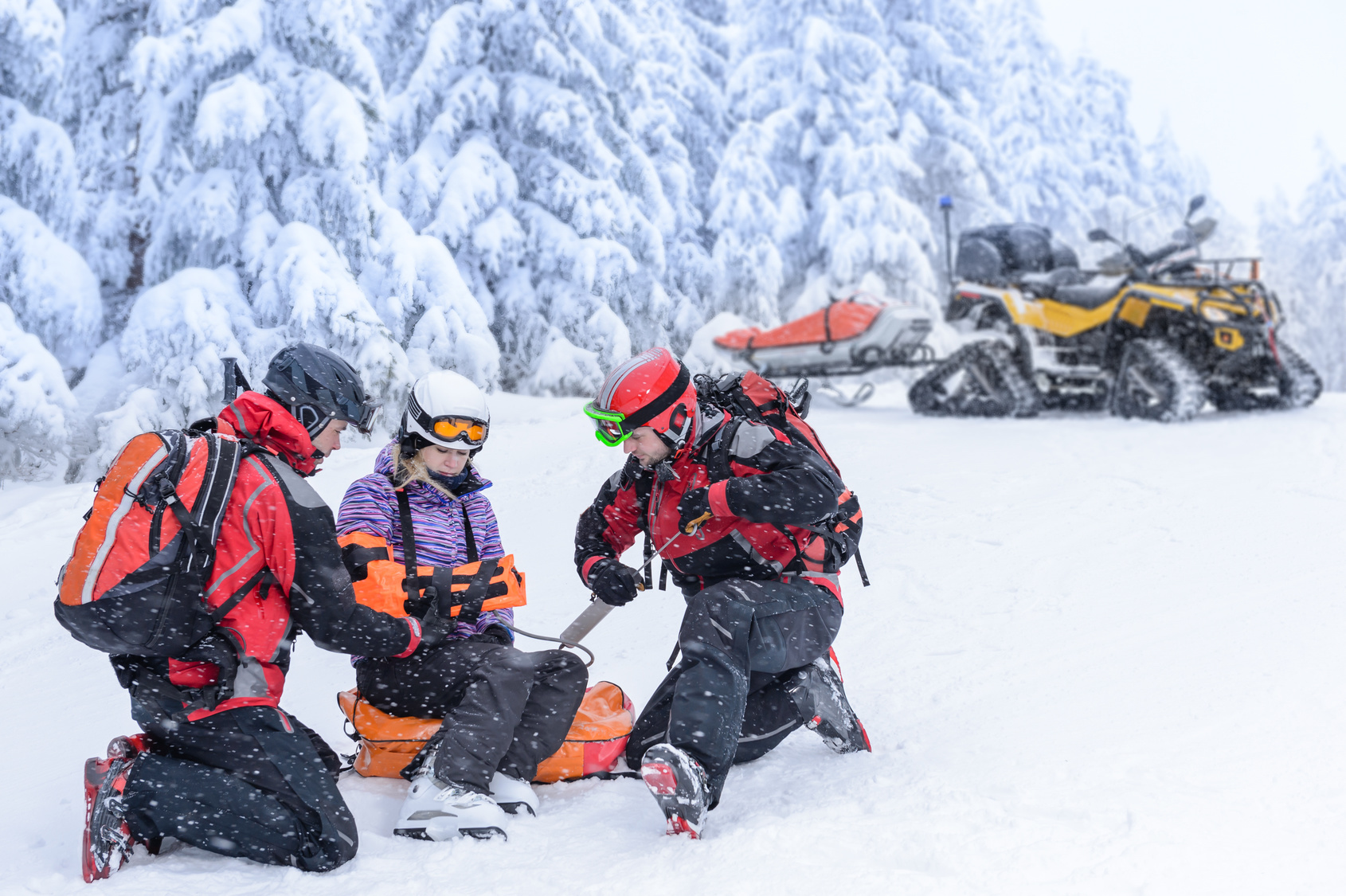 Injured skier being helped by medical ski patrol at a Colorado ski resort