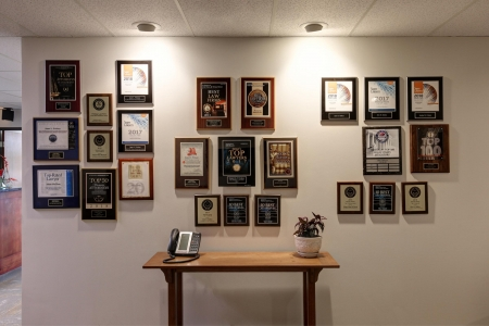 wall with awards and recognitions for Frickey Law Firm in Lakewood, CO
