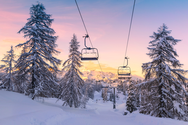 Empty chairlift at sunset at a ski resort after a snowstorm