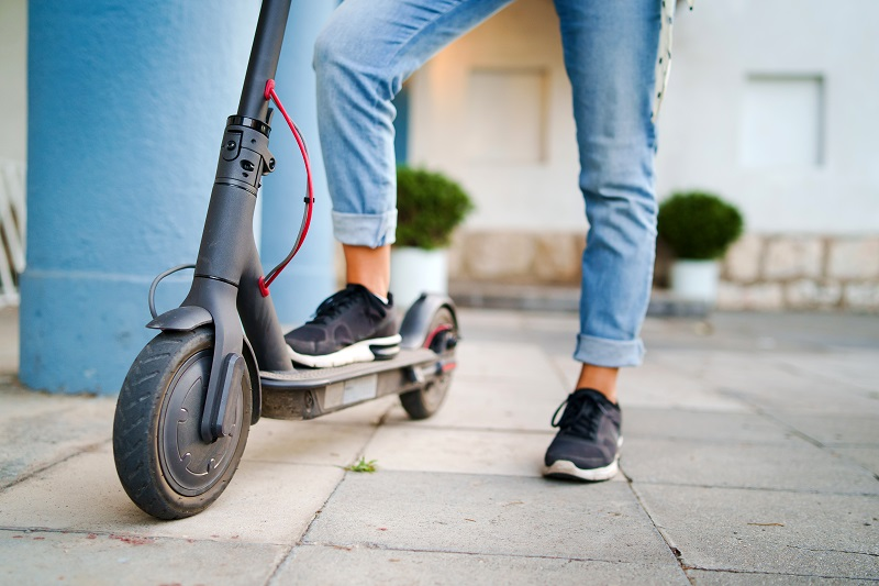 Woman riding e-scooter in Denver
