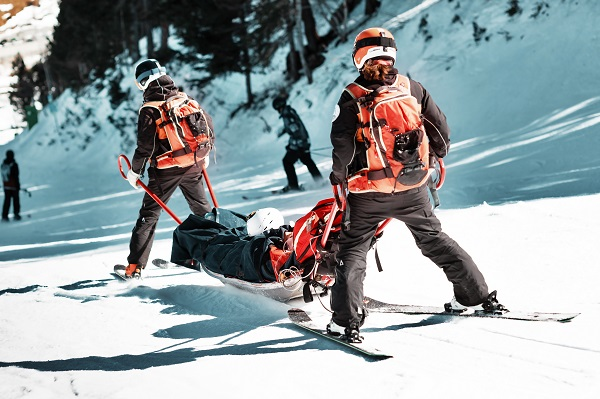 ski patrol with injured skier