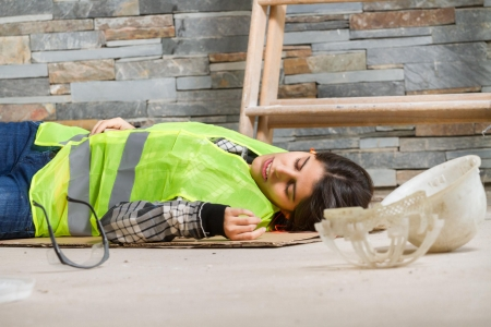 woman lying on ground after construction site accident