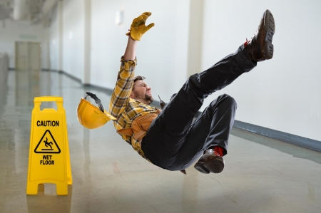 worker slipping and falling on wet floor