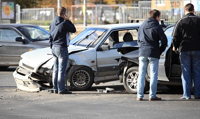 People inspecting cars after accident