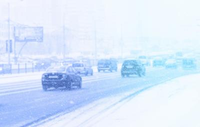 Cars Driving in Traffic in the Snow