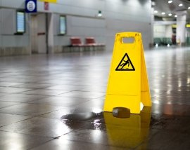 Wet Floor with Caution Sign Posted - Premises Liability Attorneys Near Columbus, GA