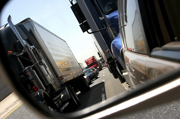 Trucks stuck in traffic with passenger vehicles
