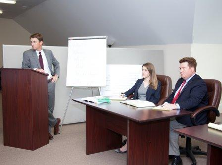 attorneys Robert Varner, Kristen Campbell and Mitchell Ladson in mock trial