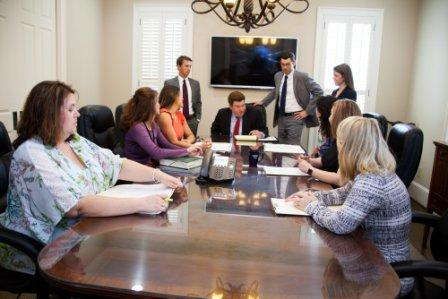 attorneys and staff meeting in conference room for personal injury case | Law Offices of Gary Bruce