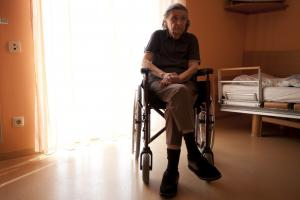Sad elderly person in wheelchair | Nursing home abuse lawyer | Law Offices of Gary Bruce