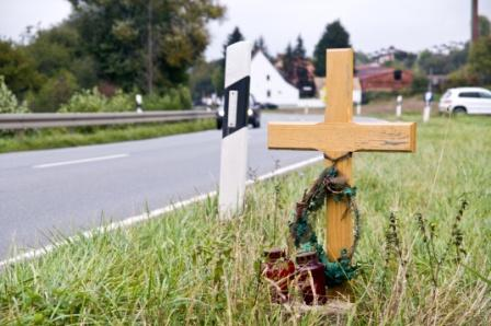 roadside marker for victim who died in car accident