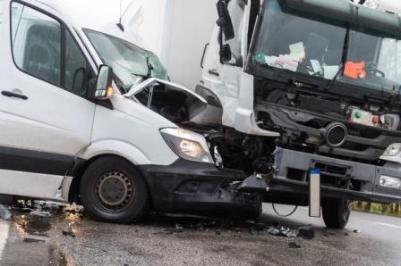collision between van and semi truck