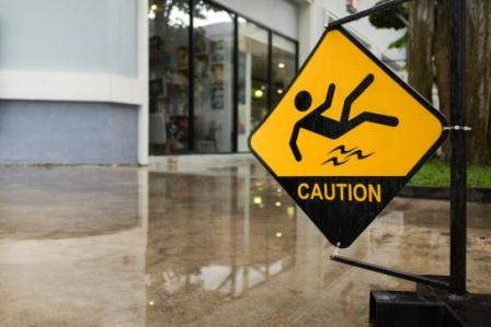 caution sign over wet floor in office building foyer