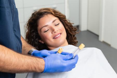 A Woman Looking at Her PRP Before Injection