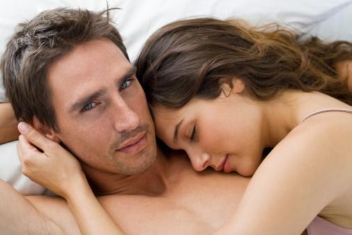 man and woman cuddling